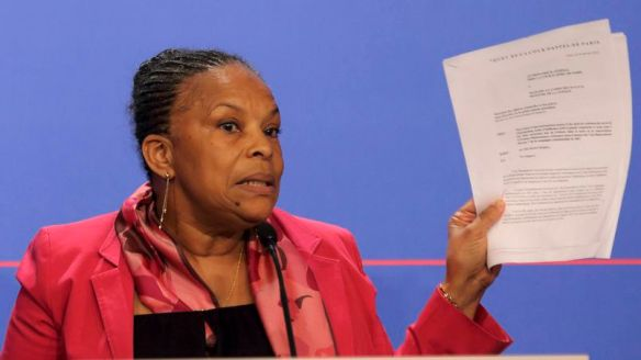 French Justice Minister Taubira holds copies of the wiretapping memos during a news conference at the Elysee Palace in Paris