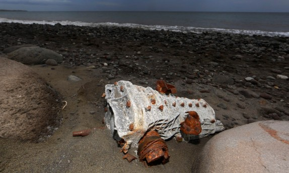 Debris that has washed onto the Jamaique beach in Saint-Denis is seen on the shoreline of French Indian Ocean island of La Reunion, August 3, 2015. REUTERS/Jacky Naegelen